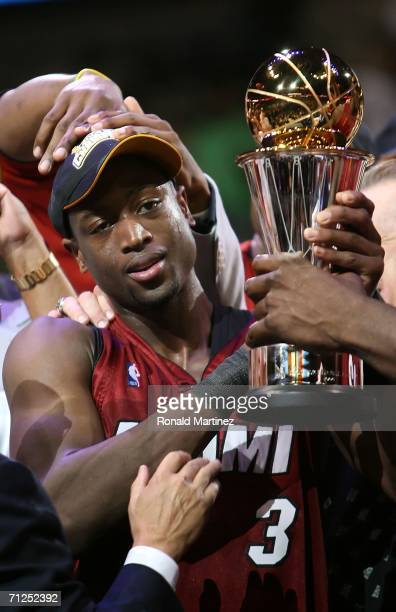 Dwyane Wade of the Miami Heat holds up the MVP trophy after the Heat defeated the Dallas Mavericks in game six of the 2006 NBA Finals on June 20 2006...