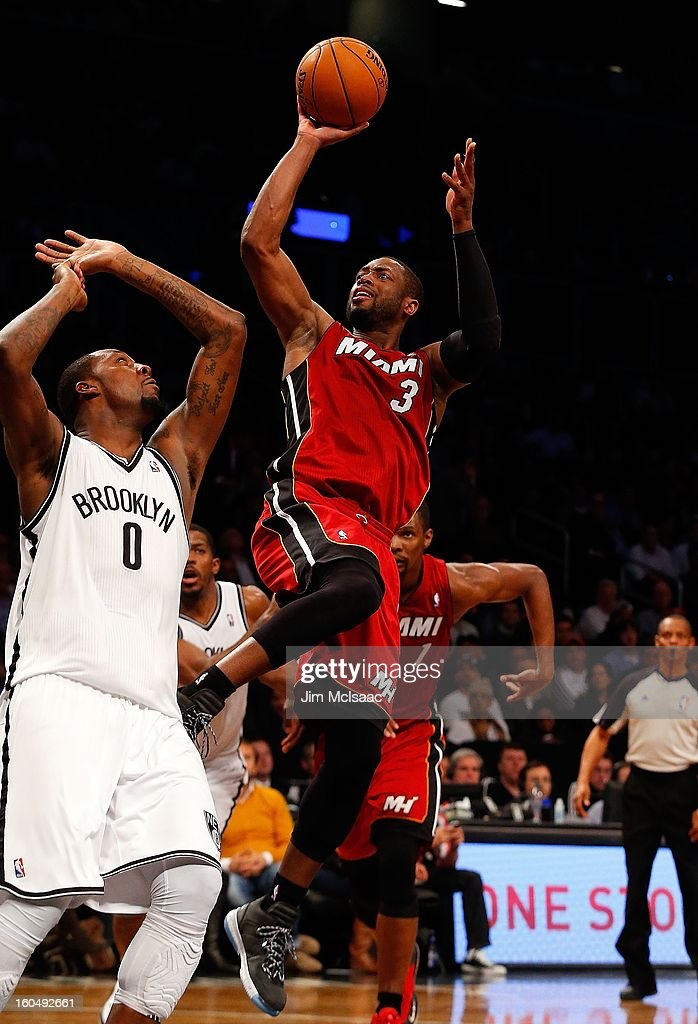 Dwyane Wade #3 of the Miami Heat in action against Andray Blatche #0 of the Brooklyn Nets at Barclays Center on January 30, 2013 in the Brooklyn borough of New York City.The Heat defeated the Nets 105-85.