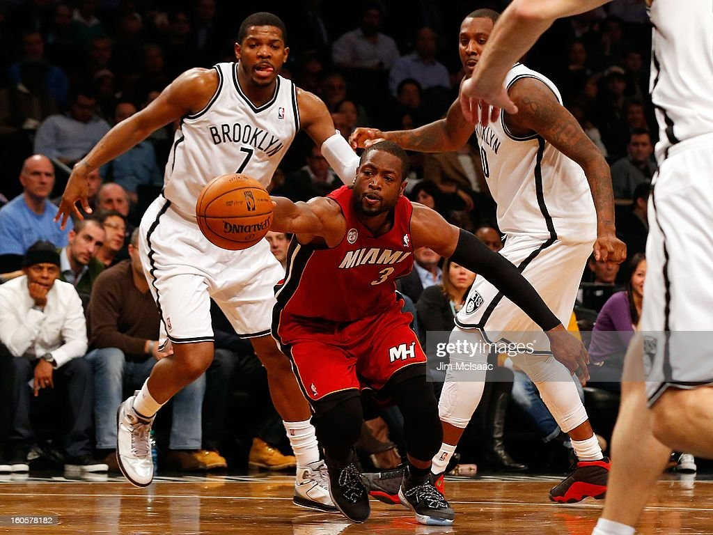 Dwyane Wade #3 of the Miami Heat in action against Joe Johnson #7 and Andray Blatche #0 of the Brooklyn Nets at Barclays Center on January 30, 2013 in the Brooklyn borough of New York City.The Heat defeated the Nets 105-85.