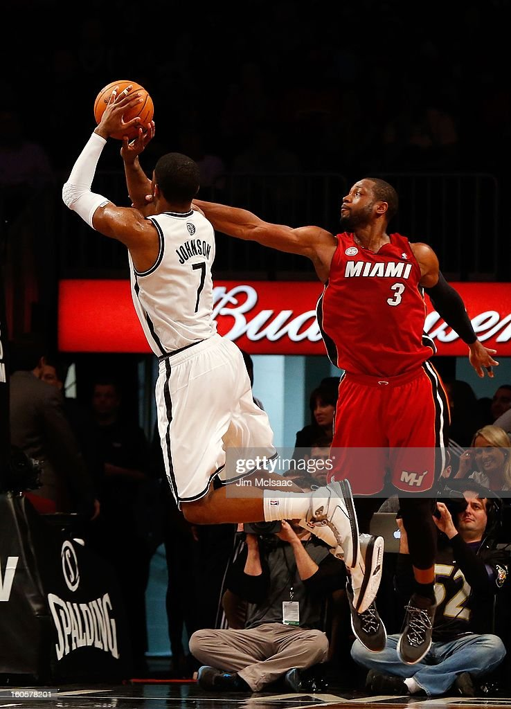 Dwyane Wade #3 of the Miami Heat in action against Joe Johnson #7 of the Brooklyn Nets at Barclays Center on January 30, 2013 in the Brooklyn borough of New York City.The Heat defeated the Nets 105-85.