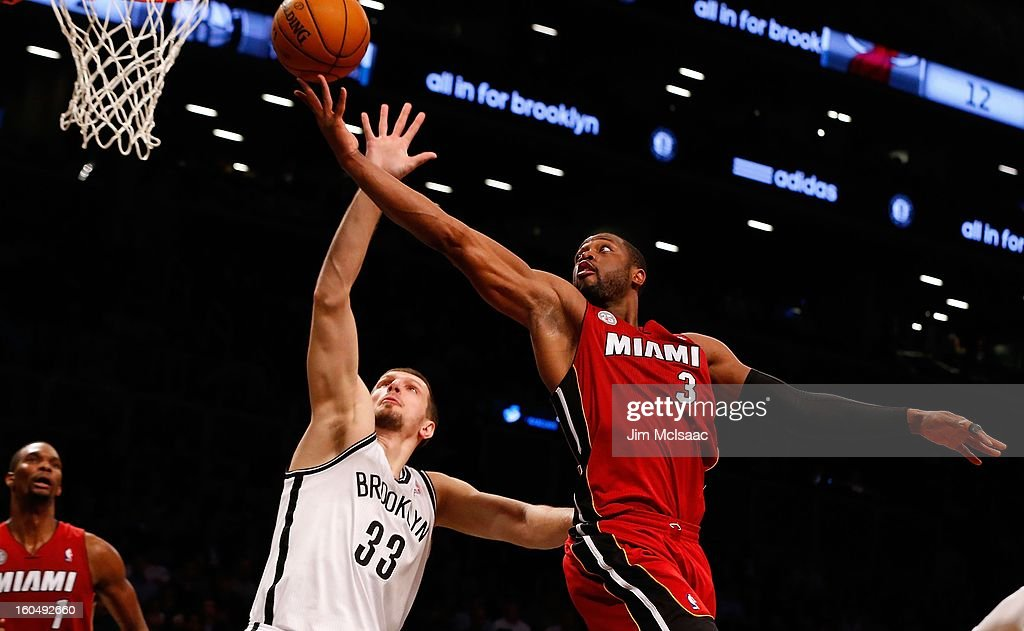 Dwyane Wade #3 of the Miami Heat in action against Mirza Teletovic #33 of the Brooklyn Nets at Barclays Center on January 30, 2013 in the Brooklyn borough of New York City.The Heat defeated the Nets 105-85.