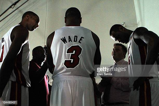 Dwyane Wade of the Miami Heat is flanked by teammates Chris Bosh and LeBron James as they answer questions during media day at the Bank United Center...