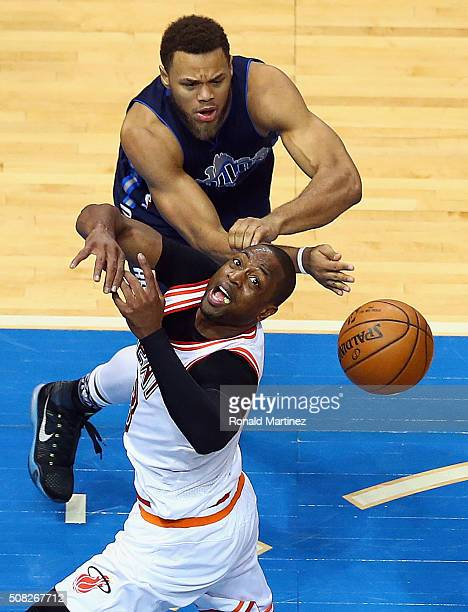 Dwyane Wade of the Miami Heat is fouled by Justin Anderson of the Dallas Mavericks in the second half at American Airlines Center on February 3 2016...