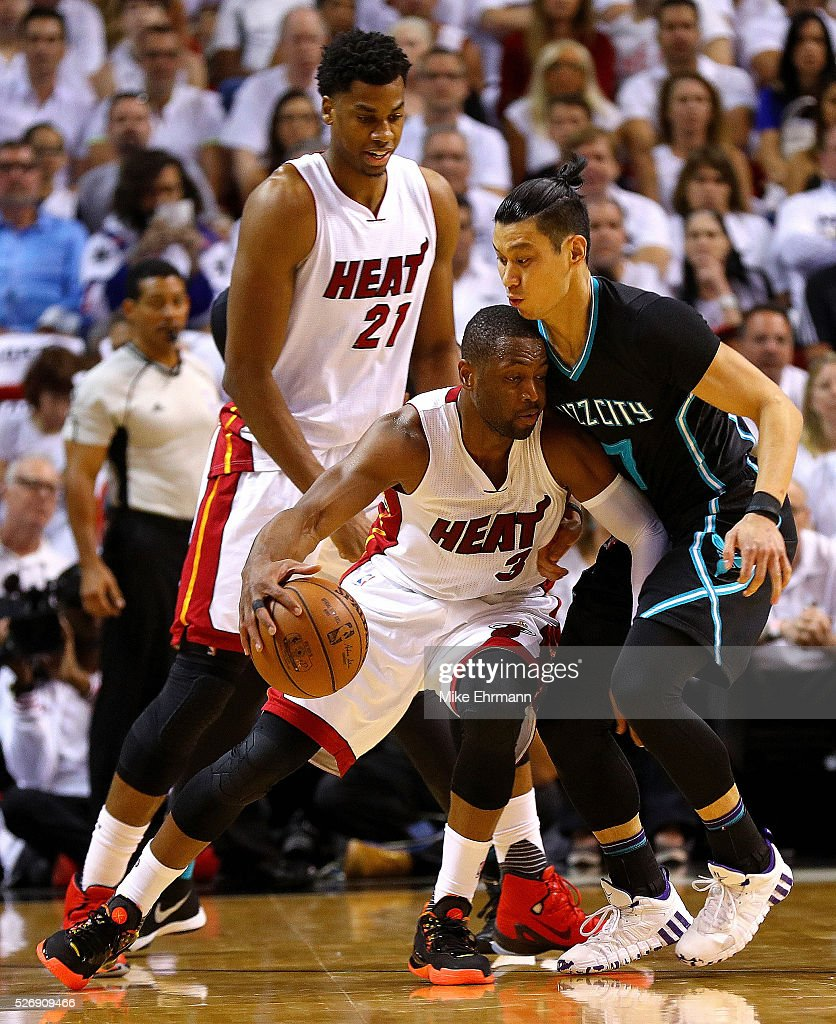 <a gi-track='captionPersonalityLinkClicked' href=/galleries/search?phrase=Dwyane+Wade&family=editorial&specificpeople=201481 ng-click='$event.stopPropagation()'>Dwyane Wade</a> #3 of the Miami Heat is guarded by <a gi-track='captionPersonalityLinkClicked' href=/galleries/search?phrase=Jeremy+Lin&family=editorial&specificpeople=6669516 ng-click='$event.stopPropagation()'>Jeremy Lin</a> #7 of the Charlotte Hornets during Game Seven of the Eastern Conference Quarterfinals of the 2016 NBA Playoffs at American Airlines Arena on May 1, 2016 in Miami, Florida.