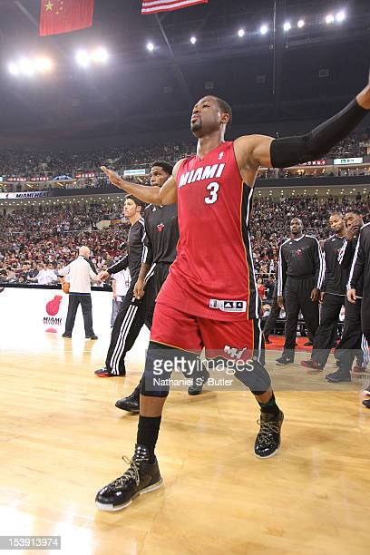 Dwyane Wade of the Miami Heat is introduced prior to the start of the preseason game against the Los Angeles Clippers during the preseason game as...