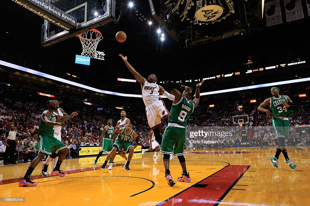 <a gi-track='captionPersonalityLinkClicked' href=/galleries/search?phrase=Dwyane+Wade&family=editorial&specificpeople=201481 ng-click='$event.stopPropagation()'>Dwyane Wade</a> #3 of the Miami Heat lays the ball up over <a gi-track='captionPersonalityLinkClicked' href=/galleries/search?phrase=Rajon+Rondo&family=editorial&specificpeople=206983 ng-click='$event.stopPropagation()'>Rajon Rondo</a> #9 of the Boston Celtics at American Airlines Arena on October 30, 2012 in Miami, Florida.