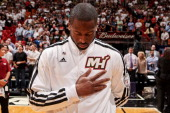 Dwyane Wade of the Miami Heat listens to the National Anthem before playing against Orlando Magic on April 17 2013 at American Airlines Arena in...