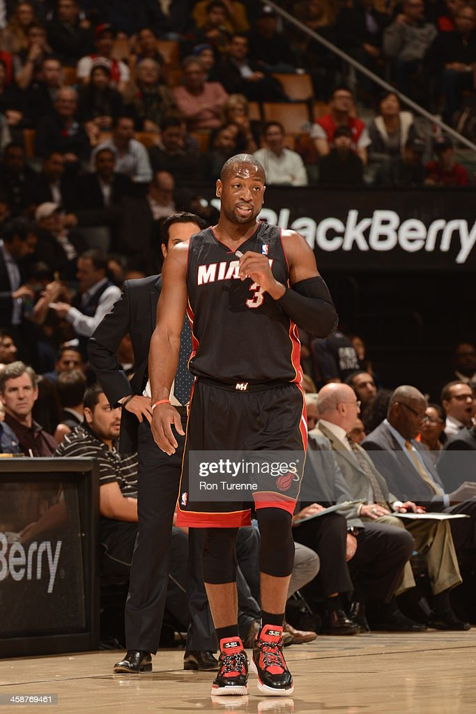 <a gi-track='captionPersonalityLinkClicked' href=/galleries/search?phrase=Dwyane+Wade&family=editorial&specificpeople=201481 ng-click='$event.stopPropagation()'>Dwyane Wade</a> #3 of the Miami Heat looks on against the Toronto Raptors during the game on November 5, 2013 at the Air Canada Centre in Toronto, Ontario, Canada.