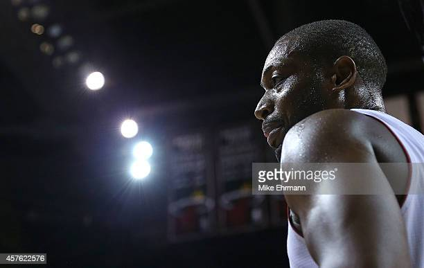 Dwyane Wade of the Miami Heat looks on during a preseason game against the Houston Rockets at American Airlines Arena on October 21 2014 in Miami...