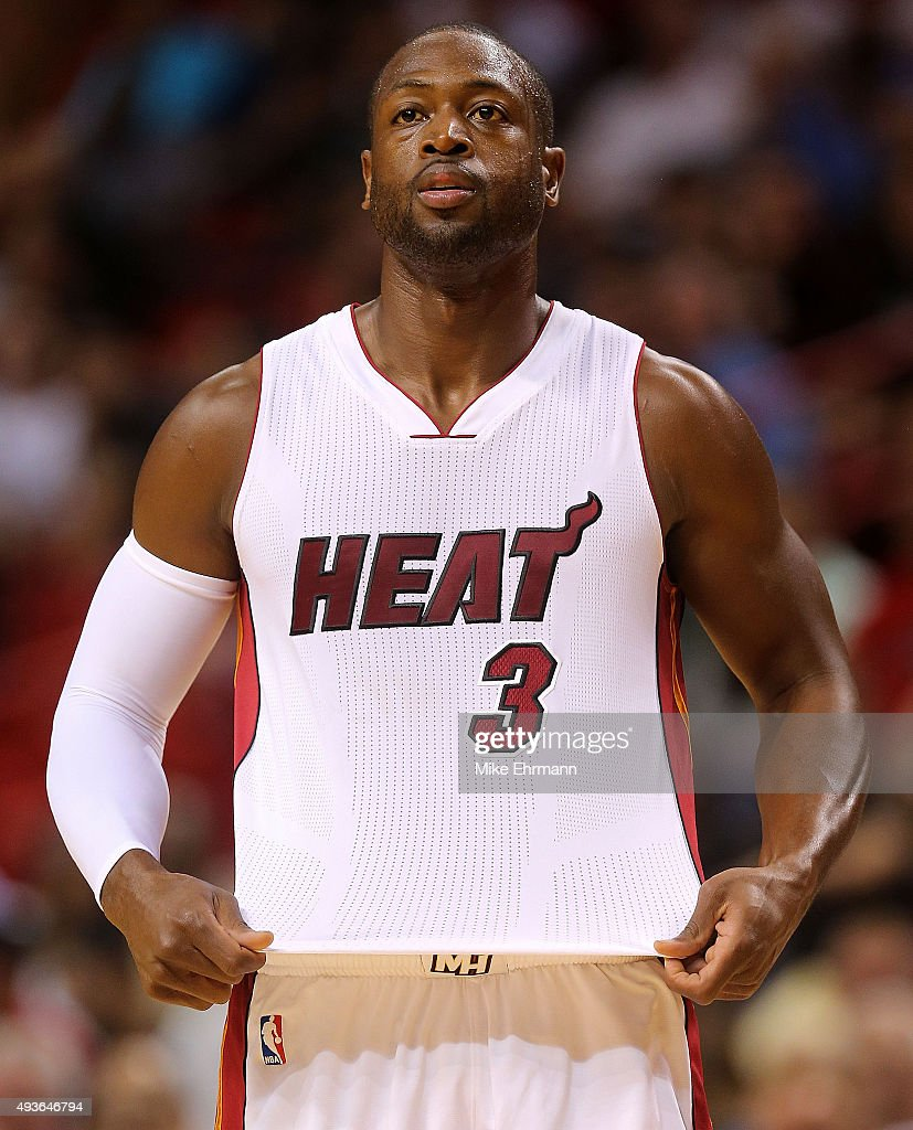 <a gi-track='captionPersonalityLinkClicked' href=/galleries/search?phrase=Dwyane+Wade&family=editorial&specificpeople=201481 ng-click='$event.stopPropagation()'>Dwyane Wade</a> #3 of the Miami Heat looks on during a preseason game against the Washington Wizards at American Airlines Arena on October 21, 2015 in Miami, Florida.