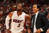Dwyane Wade of the Miami Heat looks on with Head Coach Erik Spoelstra during the game against the Memphis Grizzlies on December 27 2014 at American...