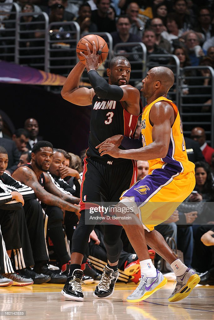 <a gi-track='captionPersonalityLinkClicked' href=/galleries/search?phrase=Dwyane+Wade&family=editorial&specificpeople=201481 ng-click='$event.stopPropagation()'>Dwyane Wade</a> #3 of the Miami Heat looks to pass against <a gi-track='captionPersonalityLinkClicked' href=/galleries/search?phrase=Kobe+Bryant&family=editorial&specificpeople=201466 ng-click='$event.stopPropagation()'>Kobe Bryant</a> #24 of the Los Angeles Lakers at Staples Center on January 17, 2013 in Los Angeles, California.