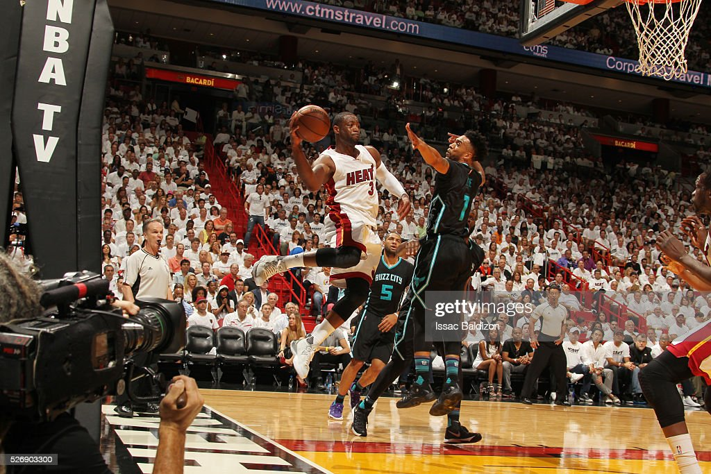 <a gi-track='captionPersonalityLinkClicked' href=/galleries/search?phrase=Dwyane+Wade&family=editorial&specificpeople=201481 ng-click='$event.stopPropagation()'>Dwyane Wade</a> #3 of the Miami Heat looks to pass against the Charlotte Hornets in Game Seven of the Eastern Conference Quarterfinals during the 2016 NBA Playoffs on May 1, 2016 at American Airlines Arena in Miami, Florida.