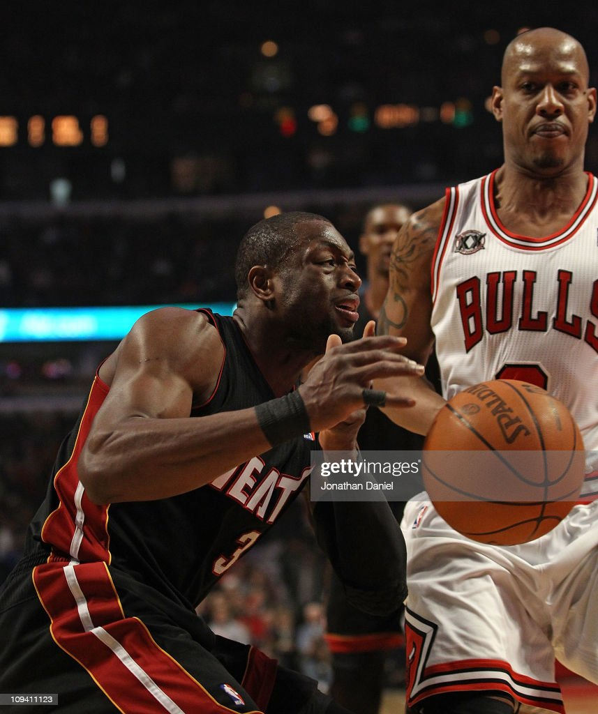 Dwyane Wade #3 of the Miami Heat looses control of the ball as he moves against Keith Bogans #6 of the Chicago Bulls at the United Center on February 24, 2011 in Chicago, Illinois.