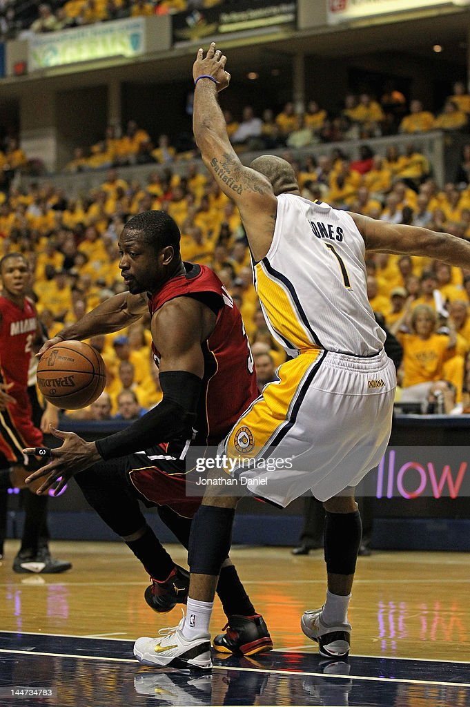 <a gi-track='captionPersonalityLinkClicked' href=/galleries/search?phrase=Dwyane+Wade&family=editorial&specificpeople=201481 ng-click='$event.stopPropagation()'>Dwyane Wade</a> #3 of the Miami Heat looses his balance as he moves against <a gi-track='captionPersonalityLinkClicked' href=/galleries/search?phrase=Dahntay+Jones&family=editorial&specificpeople=202206 ng-click='$event.stopPropagation()'>Dahntay Jones</a> #1 of the Indiana Pacers in Game Three of the Eastern Conference Semifinals in the 2012 NBA Playoffs at Bankers Life Fieldhouse on May 17, 2012 in Indianapolis, Indiana. The Pacers defeated the Heat 94-75.