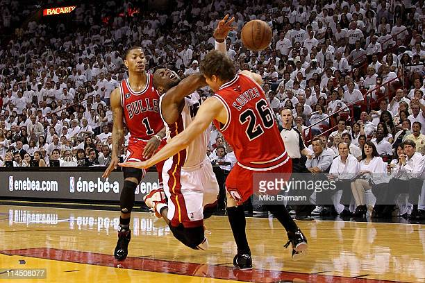 Dwyane Wade of the Miami Heat loses the ball as he drives against Kyle Korver and Derrick Rose of the Chicago Bulls in Game Three of the Eastern...