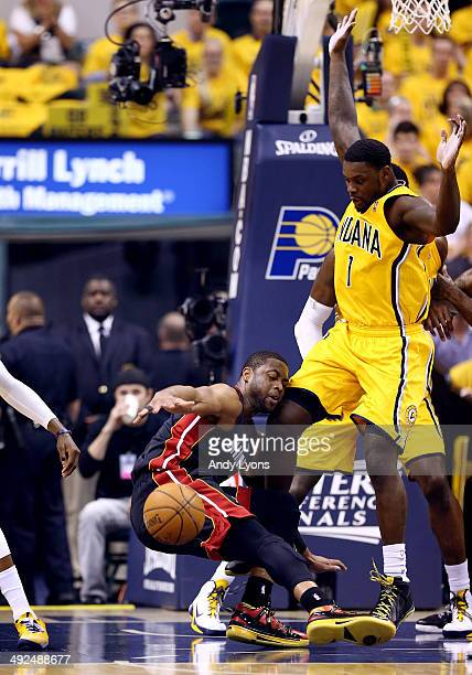Dwyane Wade of the Miami Heat loses the ball as Lance Stephenson of the Indiana Pacers defends during Game Two of the Eastern Conference Finals of...