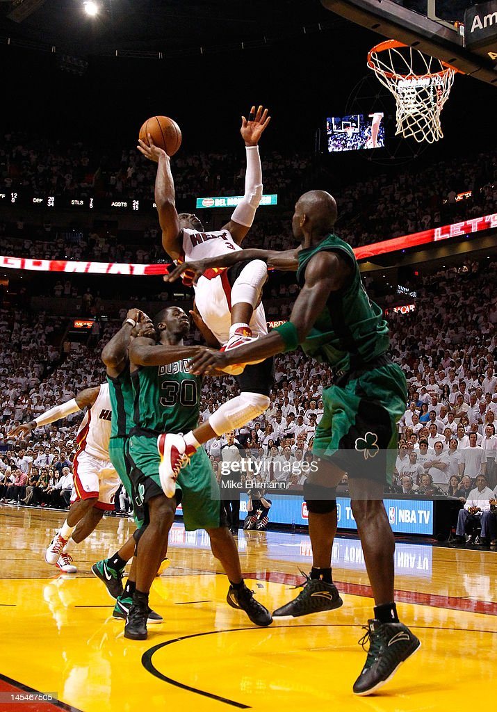 <a gi-track='captionPersonalityLinkClicked' href=/galleries/search?phrase=Dwyane+Wade&family=editorial&specificpeople=201481 ng-click='$event.stopPropagation()'>Dwyane Wade</a> #3 of the Miami Heat makes a basket and draws a foul against <a gi-track='captionPersonalityLinkClicked' href=/galleries/search?phrase=Kevin+Garnett&family=editorial&specificpeople=201473 ng-click='$event.stopPropagation()'>Kevin Garnett</a> #5 of the Boston Celtics in overtime of Game Two of the Eastern Conference Finals in the 2012 NBA Playoffs on May 30, 2012 at American Airlines Arena in Miami, Florida.