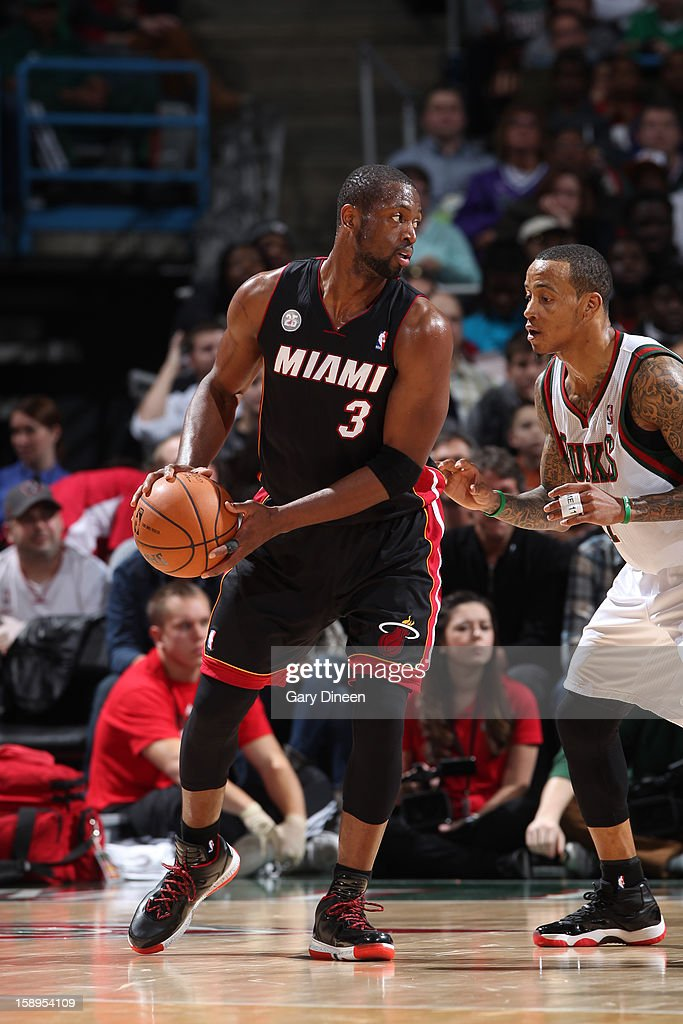 <a gi-track='captionPersonalityLinkClicked' href=/galleries/search?phrase=Dwyane+Wade&family=editorial&specificpeople=201481 ng-click='$event.stopPropagation()'>Dwyane Wade</a> #3 of the Miami Heat makes a move against <a gi-track='captionPersonalityLinkClicked' href=/galleries/search?phrase=Monta+Ellis&family=editorial&specificpeople=567403 ng-click='$event.stopPropagation()'>Monta Ellis</a> #11 of the Milwaukee Bucks on December 29, 2012 at the BMO Harris Bradley Center in Milwaukee, Wisconsin.