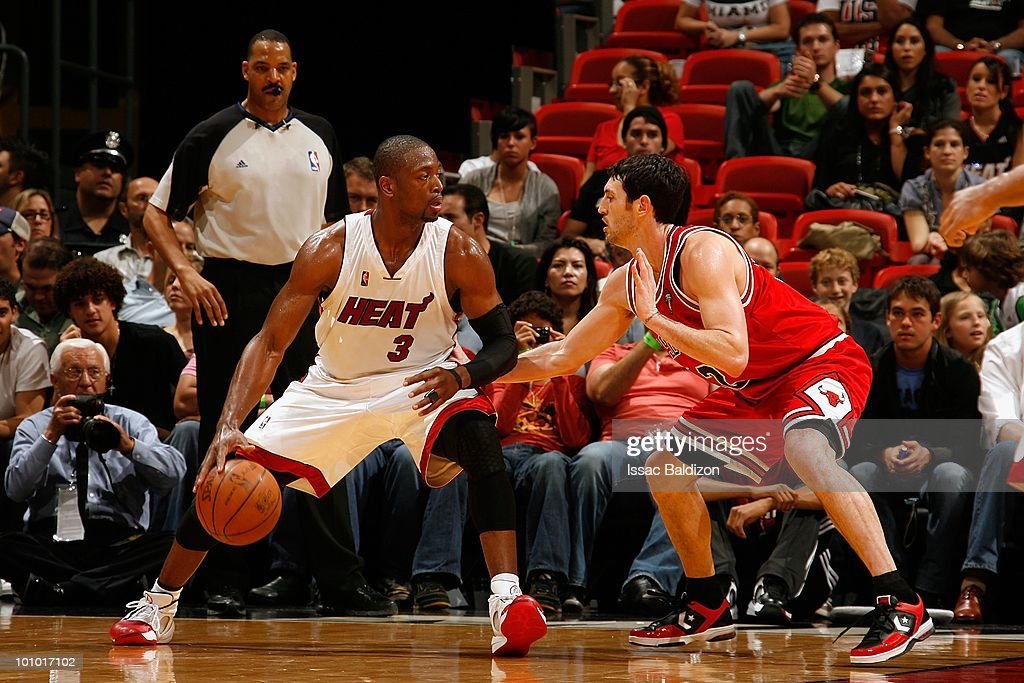 Dwyane Wade #3 of the Miami Heat moves the ball against Kirk Hinrich #12 of the Chicago Bulls during the game on March 12, 2010 at American Airlines Arena in Miami, Florida. The Heat won 108-95.