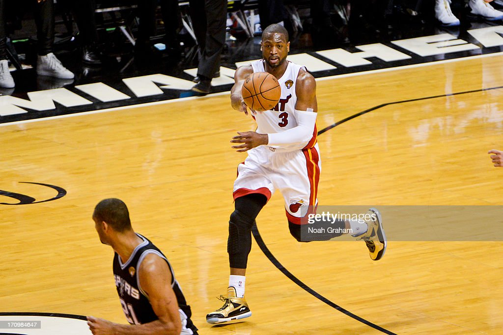 Dwyane Wade #3 of the Miami Heat passes the ball against the San Antonio Spurs during Game Seven of the 2013 NBA Finals on June 20, 2013 at American Airlines Arena in Miami, Florida.