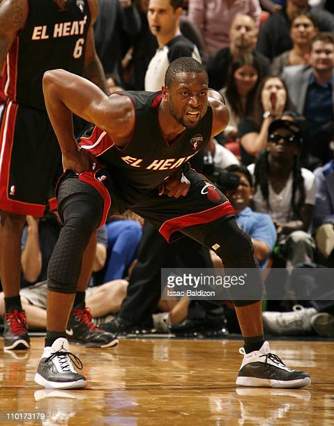 Dwyane Wade of the Miami Heat plays defense during the game against the Los Angeles Lakers on March 10 2011 at American Airlines Arena in Miami...
