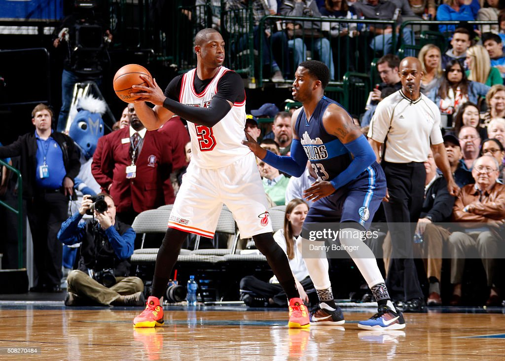 Dwyane Wade #3 of the Miami Heat posts up against Wesley Matthews #23 of the Dallas Mavericks on February 3, 2016 at the American Airlines Center in Dallas, Texas.