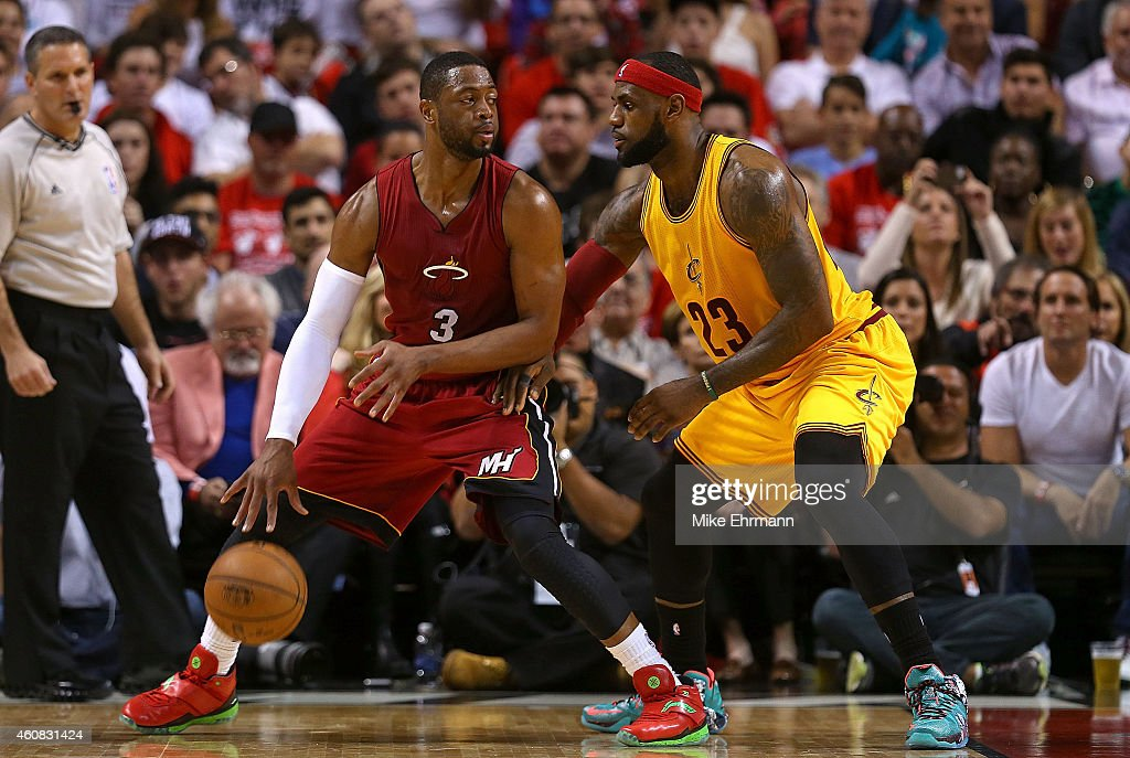 <a gi-track='captionPersonalityLinkClicked' href=/galleries/search?phrase=Dwyane+Wade&family=editorial&specificpeople=201481 ng-click='$event.stopPropagation()'>Dwyane Wade</a> #3 of the Miami Heat posts up <a gi-track='captionPersonalityLinkClicked' href=/galleries/search?phrase=LeBron+James&family=editorial&specificpeople=201474 ng-click='$event.stopPropagation()'>LeBron James</a> #23 of the Cleveland Cavaliers during a game at American Airlines Arena on December 25, 2014 in Miami, Florida.
