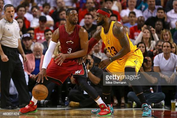 Dwyane Wade of the Miami Heat posts up LeBron James of the Cleveland Cavaliers during a game at American Airlines Arena on December 25 2014 in Miami...