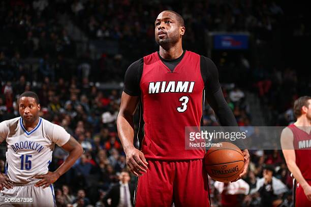 Dwyane Wade of the Miami Heat prepares to shoot a free throw against the Brooklyn Nets on January 26 2016 at Barclays Center in the Brooklyn borough...