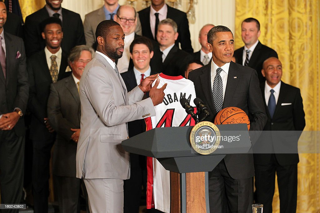 Dwyane Wade #3 of the Miami Heat presents a jersey to President Barack Obama during a visit by the Miami Heat to the White House to commemorate the 2012 NBA Champions on January 28, 2013 in Washington, DC.