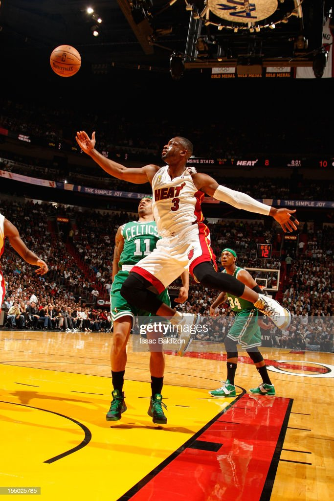 Dwyane Wade #3 of the Miami Heat reaches for a rebound against Courtney Lee #11 of the Boston Celtics during the NBA game on October 30, 2012 at American Airlines Arena in Miami, Florida.