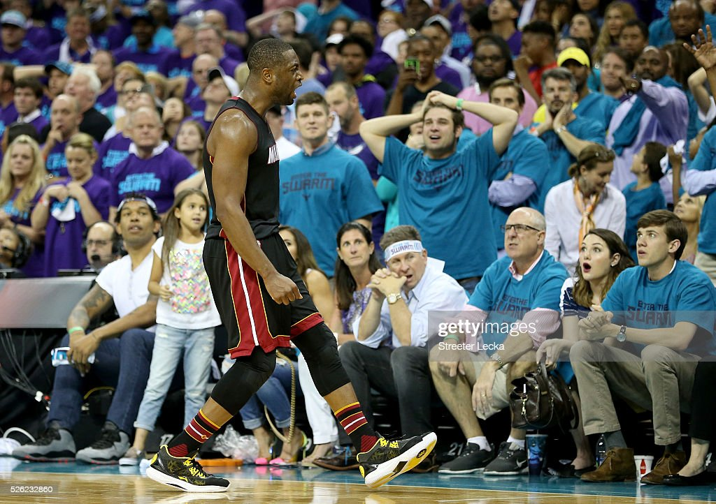 <a gi-track='captionPersonalityLinkClicked' href=/galleries/search?phrase=Dwyane+Wade&family=editorial&specificpeople=201481 ng-click='$event.stopPropagation()'>Dwyane Wade</a> #3 of the Miami Heat reacts after making a shot late in the fourth quarter against the Charlotte Hornets during game six of the Eastern Conference Quarterfinals of the 2016 NBA Playoffs at Time Warner Cable Arena on April 29, 2016 in Charlotte, North Carolina.