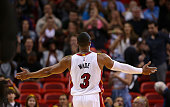 Dwyane Wade of the Miami Heat reacts to the crowd during a game against the Memphis Grizzlies at American Airlines Arena on December 27 2014 in Miami...