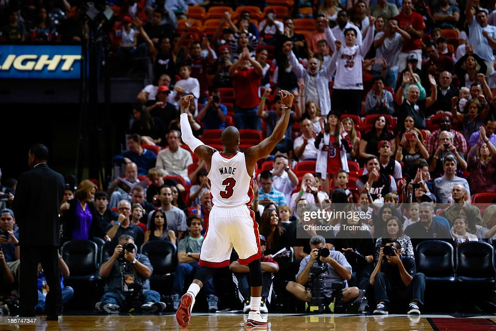 Dwyane Wade #3 of the Miami Heat reacts to the crowd prior to the game against the Washington Wizards at American Airlines Arena on November 3, 2013 in Miami, Florida.