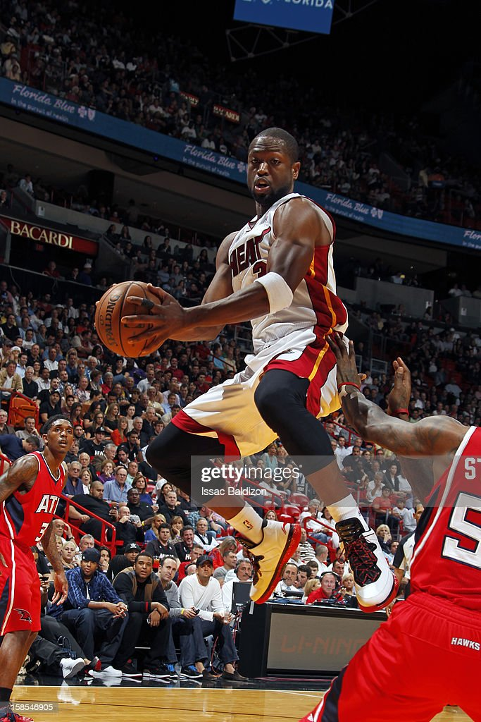 Dwyane Wade #3 of the Miami Heat rebounds the ball against the Atlanta Hawks during the game on December 10, 2012 at American Airlines Arena in Miami, Florida.