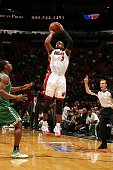 Dwyane Wade of the Miami Heat shoots a jump shot against Tony Allen of the Boston Celtics in Game Four of the Eastern Conference Quarterfinals during...