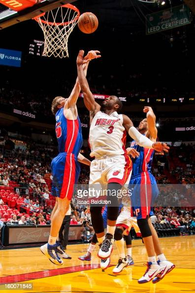 Dwyane Wade of the Miami Heat shoots a layup against Kyle Singler of the Detroit Pistons during a game on January 25 2013 at American Airlines Arena...