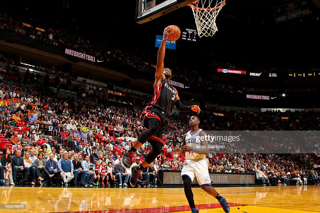 Dwyane Wade #3 of the Miami Heat shoots a layup against the Philadelphia 76ers on March 8, 2013 at American Airlines Arena in Miami, Florida.