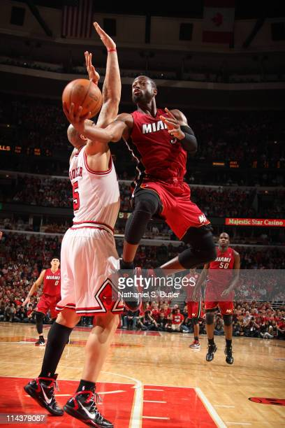 Dwyane Wade of the Miami Heat shoots against Carlos Boozer of the Chicago Bulls during Game Two of the Eastern Conference Finals during the 2011 NBA...