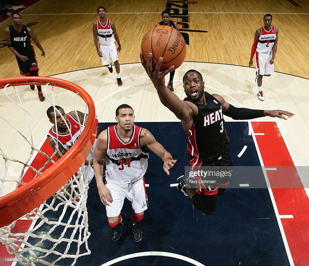 <a gi-track='captionPersonalityLinkClicked' href=/galleries/search?phrase=Dwyane+Wade&family=editorial&specificpeople=201481 ng-click='$event.stopPropagation()'>Dwyane Wade</a> #3 of the Miami Heat shoots against <a gi-track='captionPersonalityLinkClicked' href=/galleries/search?phrase=JaVale+McGee&family=editorial&specificpeople=4195625 ng-click='$event.stopPropagation()'>JaVale McGee</a> #34 of the Washington Wizards during the game at the Verizon Center on February 10, 2012 in Washington, DC.