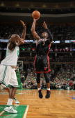 Dwyane Wade of the Miami Heat shoots against Kendrick Perkins of the Boston Celtics in Game Five of the Eastern Conference Quarterfinals during the...