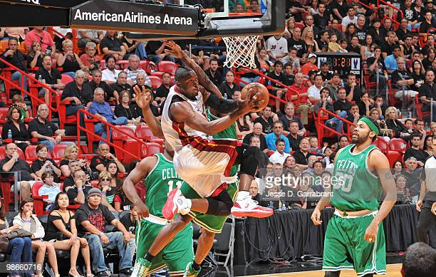 Dwyane Wade of the Miami Heat shoots against Rasheed Wallace of the Boston Celtics in Game Four of the Eastern Conference Quarterfinals during the...