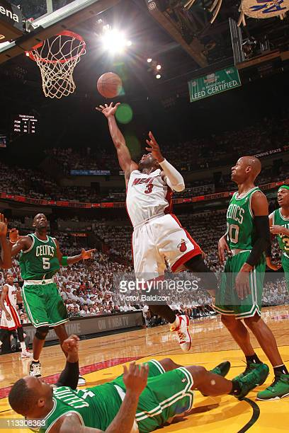 Dwyane Wade of the Miami Heat shoots against Ray Allen and Glen Davis of the Boston Celtics in Game One of the Eastern Conference Semifinals in the...