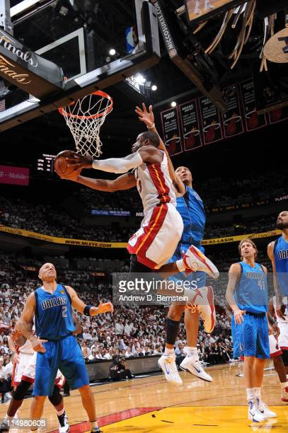 Dwyane Wade of the Miami Heat shoots against Shawn Marion of the Dallas Mavericks during Game One of the 2011 NBA Finals on May 31 2011 at the...