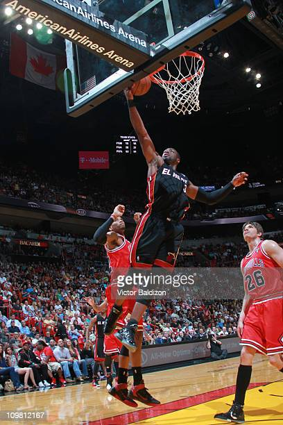 Dwyane Wade of the Miami Heat shoots against Taj Gibson of the Chicago Bulls on March 6 2011 at American Airlines Arena in Miami Florida NOTE TO USER...