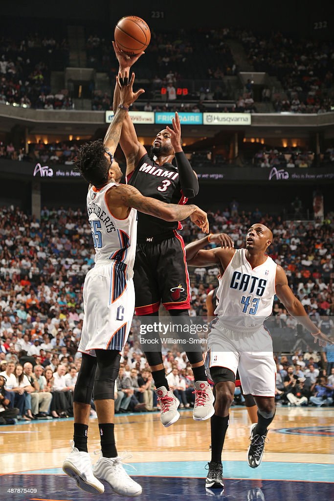 <a gi-track='captionPersonalityLinkClicked' href=/galleries/search?phrase=Dwyane+Wade&family=editorial&specificpeople=201481 ng-click='$event.stopPropagation()'>Dwyane Wade</a> #3 of the Miami Heat shoots against the Charlotte Bobcats in Game One of the Eastern Conference Quarterfinals of the 2014 NBA playoffs at the Time Warner Cable Arena on April 28, 2014 in Charlotte, North Carolina.