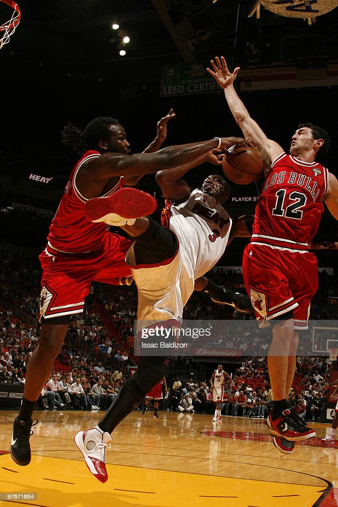 Dwyane Wade #3 of the Miami Heat shoots against the Chicago Bulls on March 12, 2010 at American Airlines Arena in Miami, Florida.