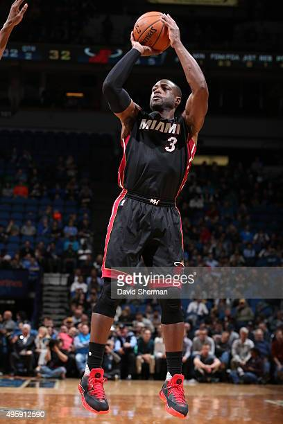 Dwyane Wade of the Miami Heat shoots against the Minnesota Timberwolves on November 5 2015 at Target Center in Minneapolis Minnesota NOTE TO USER...