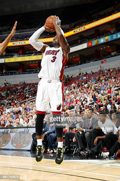 Dwyane Wade of the Miami Heat shoots against the Orlando Magic during a preseason game on October 7 2015 at KFC Yum Center in Louisville Kentucky...